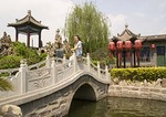 Classical Chinese garden with pond and stone bridge at Qiao Family Courtyard (Qiao Jia Dayuan), 18th century merchant family mansion, setting for film Raise the Red Lantern