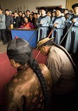Historical courtroom reenactment of county magistrate of Ming dynasty mediating dispute  between father and son in civil court in ancient city of Pingyao