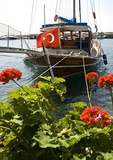 Sailboat with Turkish flag in Assos harbor