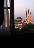 Blue Mosque through hotel window at dawn