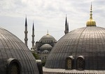 Dome of Blue Mosque viewed between domes of Aya Sofya