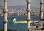 Freighter on Bosphorus passing Blue Mosque (Sultan Ahmet Cami)