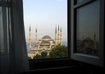 Blue Mosque through hotel window with Aya Sofya relected in window
