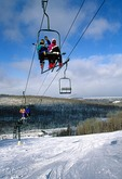 Skiers on ski lift at Marquette Mountain Ski Area, Upper Peninsula, Michigan