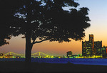 Detroit, Michigan, from Belle Isle Park in the Detroit River with lights of Ambassador Bridge to Canada and Renaissance Center in downtown