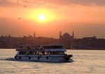 Istanbul ferry at sunset crossing Bosphorus with Aya Sofya (Hagia Sophia, Church of the Holy Wisdom)
