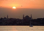 Istanbul sunset across Bosphorus with Aya Sofya (Hagia Sophia, Church of the Holy Wisdom)