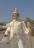Pubescent Muslim boy in traditional white satin regalia prior to circumcision ritual, near Istanbul's Eyup Mosque