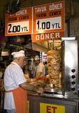 Slicing roasted lamb doner kebab in Istanbul's Egyptian Bazaar (Spice Market)