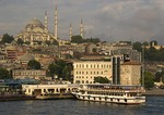 Istanbul ferry at dock on the Golden Horn with Mosque of Suleyman (Suleymaniye Cami) above