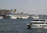 Bosphorus ferry passing cruise ships in port of Istanbul