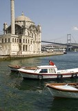 Boats along Istanbul's Bosphorus with Ortakoy Mosque and Bosphorus Bridge