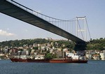 Istanbul's Fatih Sultan Mehmet Bridge with freighter on Bosphorus