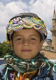 Turkish boy in ethnic clothing at festival
