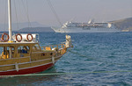 The Calypso cruise ship of Louis Cruises in port of Kusadasi with gulet in foreground.