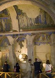 Tourists viewing frescoes in Goreme Open Air Museum, Tokali Church, in Cappadocia