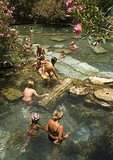 Bathers in hot springs of ancient Roman ruins of Hieropolis at Pamukkale