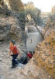 Children hiking in the Sesriem Canyon, a narrow gorge at Sossusvlei, Naukluft Park, Namibia