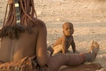 Himba mother and child in Kaokaland, near Opowu, Namibia