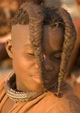 Himba girl's hairstyle in Kaokaand, near Opowu, Namibia