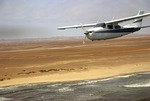 Small plane flying along Skeleton Coast, Namibia