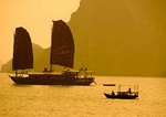Halong Bay tourist junk & small sanpan