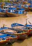 Vietnamese fishing boats on coast along South China Sea near Phan Thiet