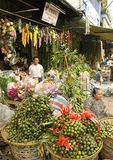 Saigon's Ben Thanh Market fruit and flower vendor