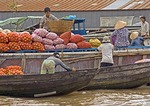 Sacks of produce at Phung Hiep floating market in the Mekong River Delta near Can Tho