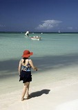 Aruba sun worshipper on white sand beach