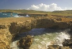 Aruba's Natural Bridge on rocky north shore of island at Boca Andicuri