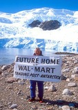 Tourist from cruise ship with Wal-Mart sign on Neko Harbor beach on Antarctic peninsula.
