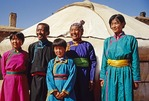 Mongolian family outside yurt on grasslands of Siziwang Banner near Hohhot in Inner Mongolia