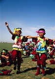 Costumed Mongolian children dancing at Naadam Summer Festival on grasslands of Siziwang Banner near Hohhot in Inner Mongolia