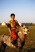 Young Mongolian horseman at Naadam Summer Festival on grasslands of Siziwang Banner near Hohhot in Inner Mongolia
