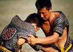 Young Mongolian wrestlers at Naadam Summer Festival on grasslands of Siziwang Banner near Hohhot in Inner Mongolia
