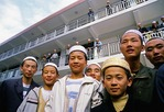 Hui Muslim students, ages 14-18,  in front of their dormitory at the Xi Chuan Mosque's Language School in Guang He, Gansu province