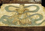 Mural mounted on wood of Buddhist celestial playing zheng ancient musical instrument at entrance to Mogao Caves near Dunhuang, Gansu Province, China