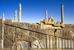 Ruins of Apadana Palace built by Darius the Great in the Persian city of Persepolis with bas relief of mythological lion attacking a bull, near Shiraz, Iran