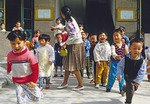 Xi'an kindergartners break for recess from morning class