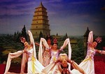 Tang Dynasty Song and Dance performance of Tales of the Silk Road in Xi'an with Big Wild Goose Pagoda (Dayan Ta) on background scenery