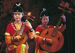 Ruan instruments being played in Tang Dynasty performance in Xi'an.  The ancient Chinese guitars are Oud-like lutes.