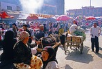 Uighurs in Khotan, Xinjiang, on busy Sunday Bazaar market day, on Southern Silk Road