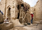 Archeologists restoring the Jiaohe Ruins on ancient Silk Road near Turpan in Xinjiang