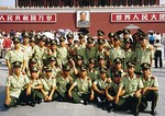 Tiananmen Gate, group of armed police pose in front of portrait of Mao Zedong