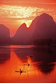 Dawn on Li River at Yangshuo with cormorant fishermen on bamboo rafts