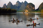 Li River at Yangshuo with cormorant fishermen on bamboo rafts