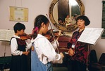A Shanghai Childrens Palace music class with violin teacher and students