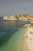 Dubrovnik beach, next to Old Town harbor, on shore of Adriatic
