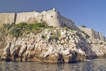 Stone city wall of Dubrovnik Old Town viewed from Adriatic